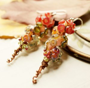 Beautiful Boro lampworks, mixed with Copper, a few pieces of Peridot, finished with Sterling Silver earwire.